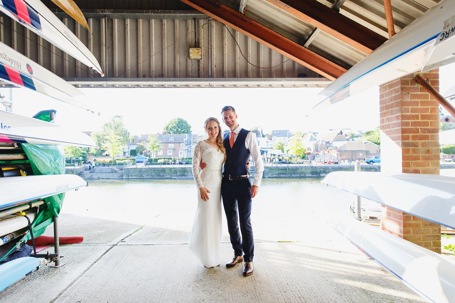A couple pose for wedidng photographs at Twickenham Rowing Club, London.