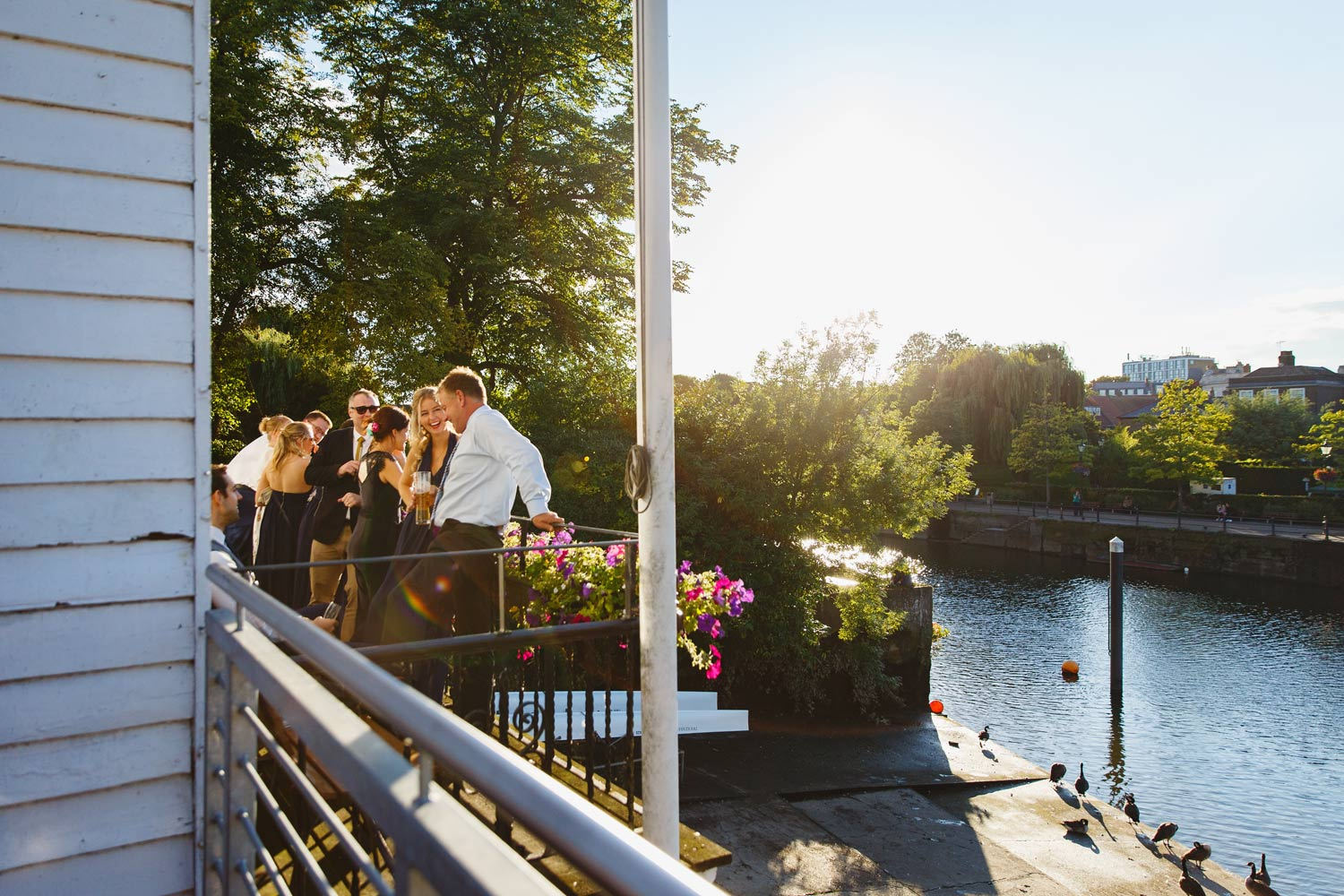 Wedding guests at Twickenham Rowing Club, London.