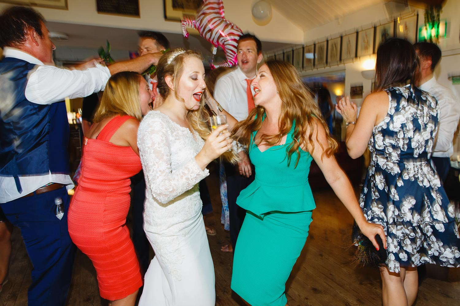 Wedding guests dance at Twickenham Rowing Club, London.